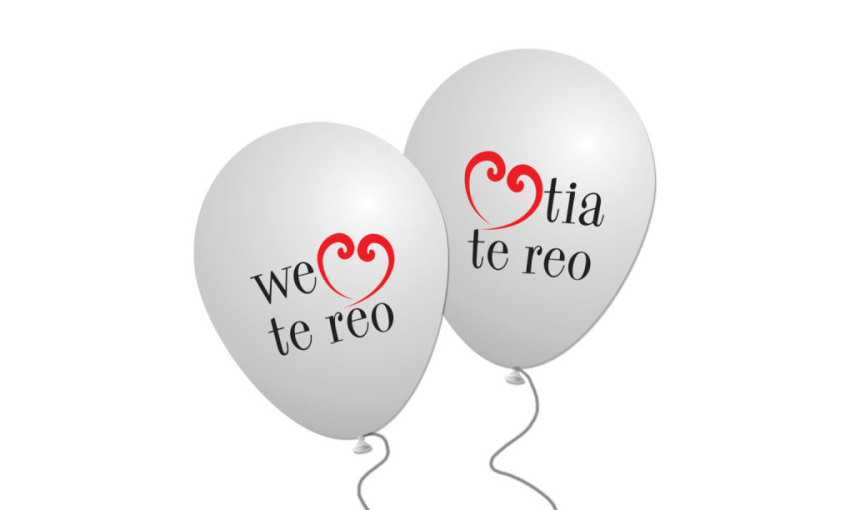 Two white ballons that say We heart te reo and arohatia te reo