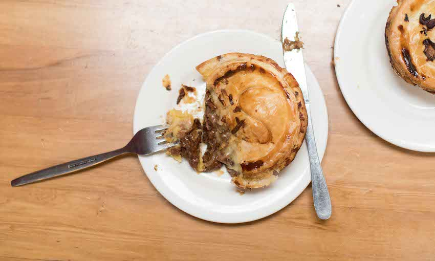 a delicious beef and blue cheese pie with golden pastry and oozing filling