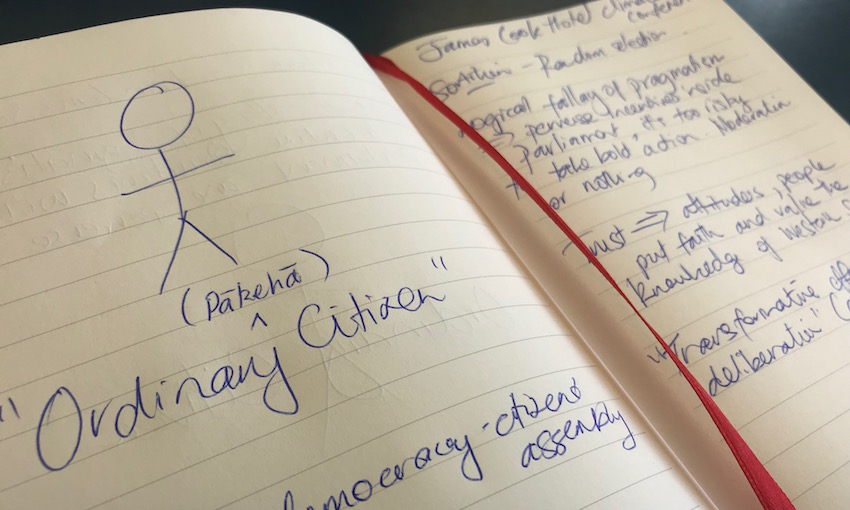 Writing in a notebook with the words 'ordinary citizen' (pākehā) written in the middle.