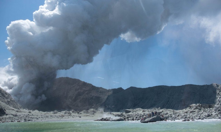 A view of the Whakaari eruption from a boat just off the island