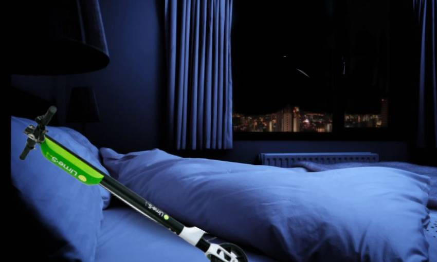 a lime scooter lies in a bed at night
