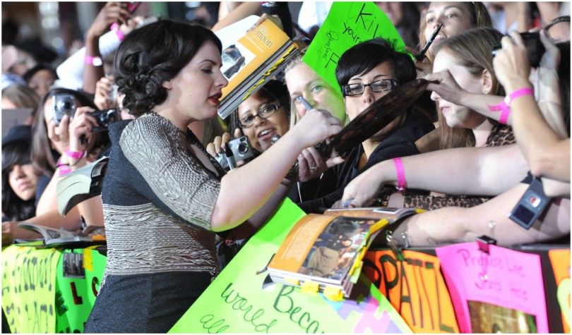 Stephenie Meyer signs autographs for a crushing crowd of fans.