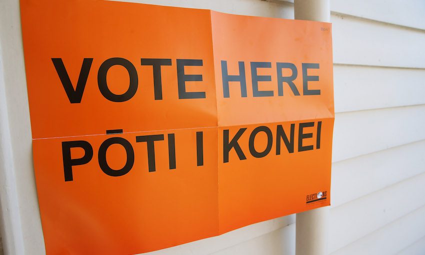 Orange sign that reads Vote here Pōti i konei