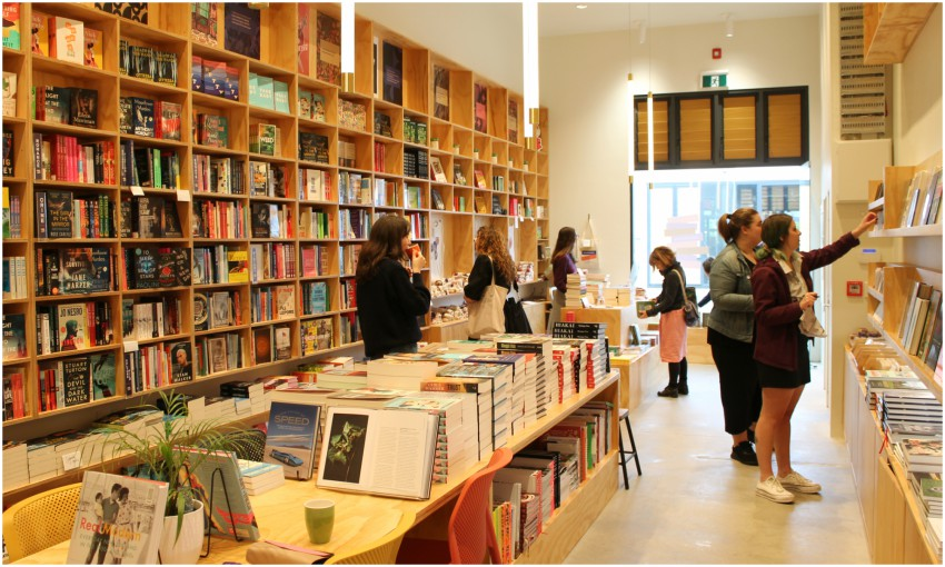 Interior of a bookstore, with customers