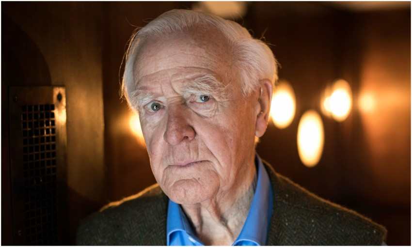 Portrait of John le Carre looking directly at camera