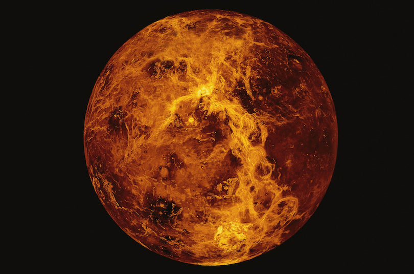 A fiery planet on black background