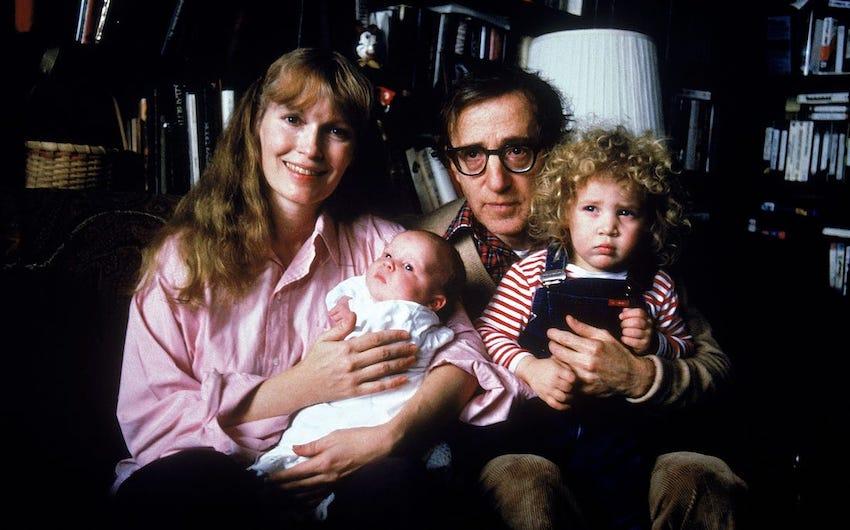 Mia Farrow, Woody Allen and two of Farrow's children.