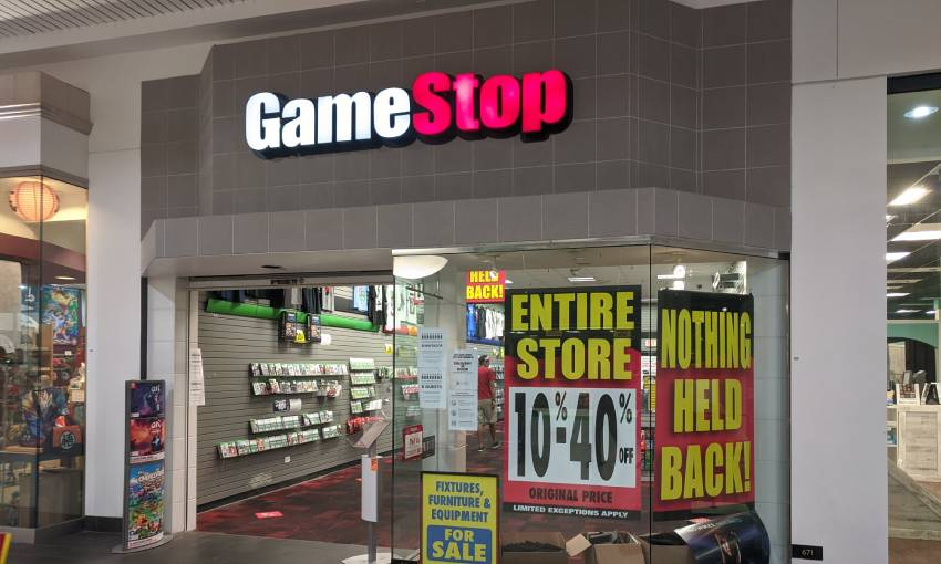 the outside of a gamestop store going into liquidation