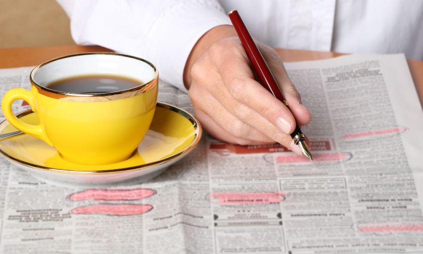 job listing with coffee cup getty
