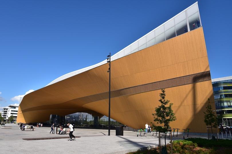 Skateboarders enjoy the area around the Oodi library in Helsinki