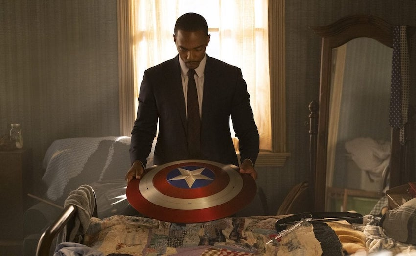 Sam Wilson (Anthony Mackie) looks over the famous shield of the departed Captain America. (Photo: Disney)