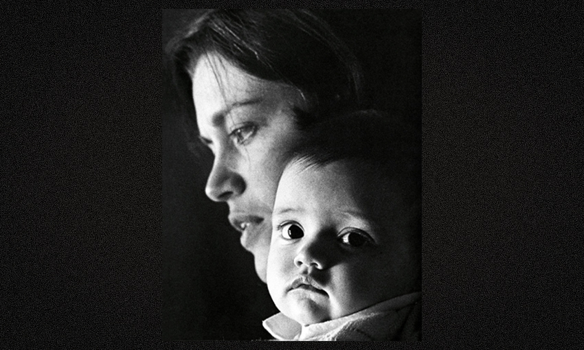 Black and white photograph of Charlotte Grimshaw as a baby with her mother, Kay.