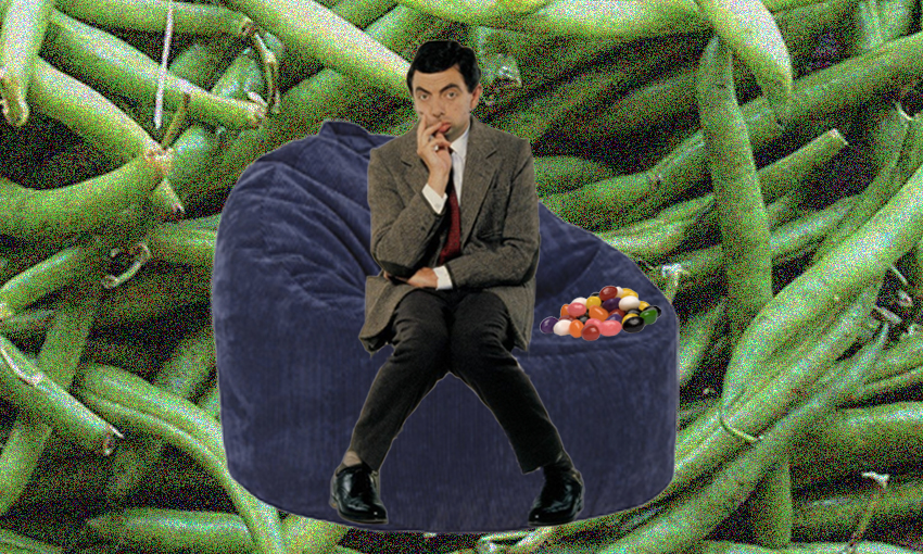 Mr Bean sitting on a bean bag with a pile of jellybeans. The background is green beans.