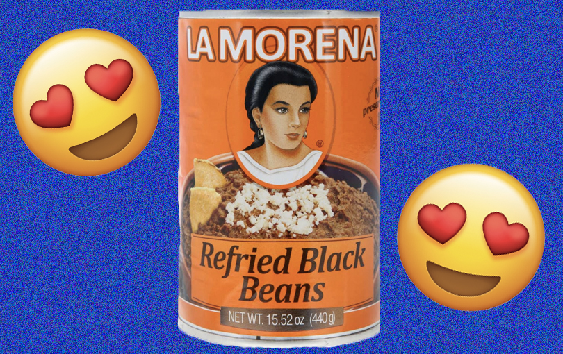 A can of La Morena refried beans with two heart eyes emojis on either side.