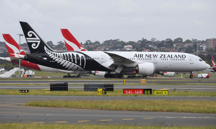Air New Zealand and Qantas planes together on runway