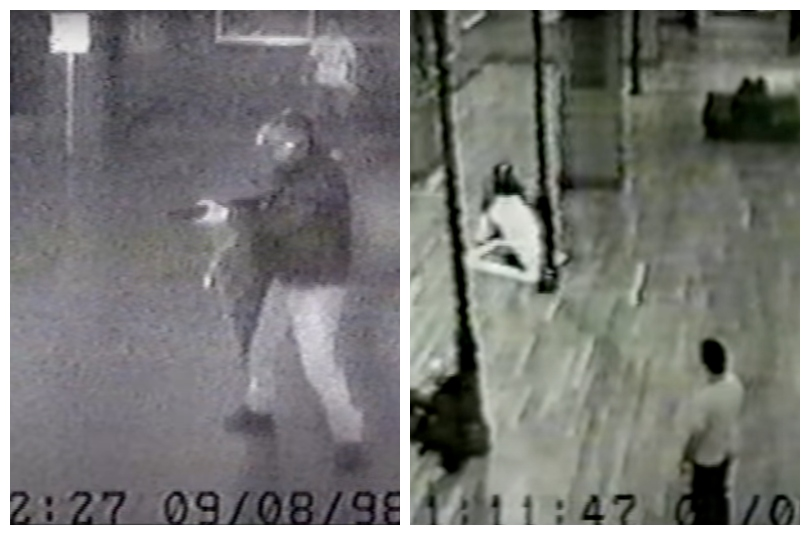 Blurry black and white security footage showing a man with a gun, and later tearing a painting out of its frame.
