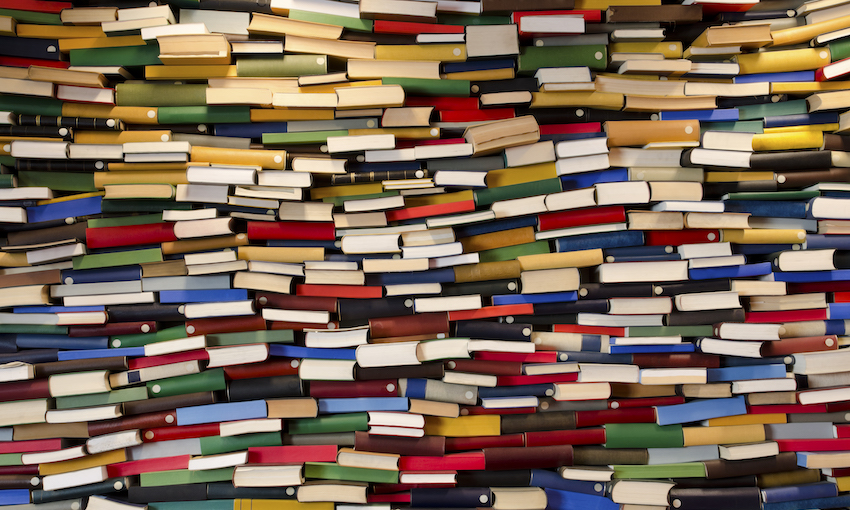 Hundreds of books piled up in a wall