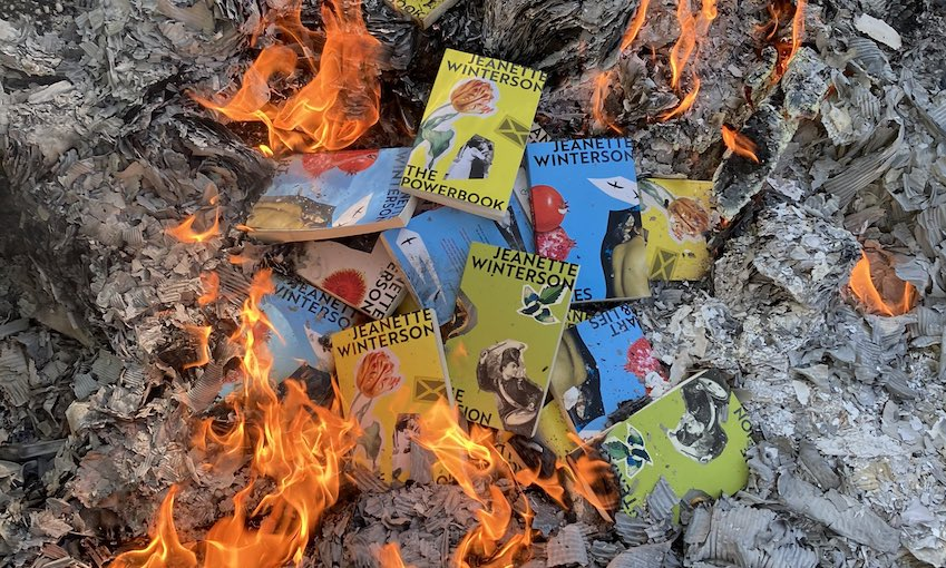 Books by Jeanette Winterson are visible in a bonfire