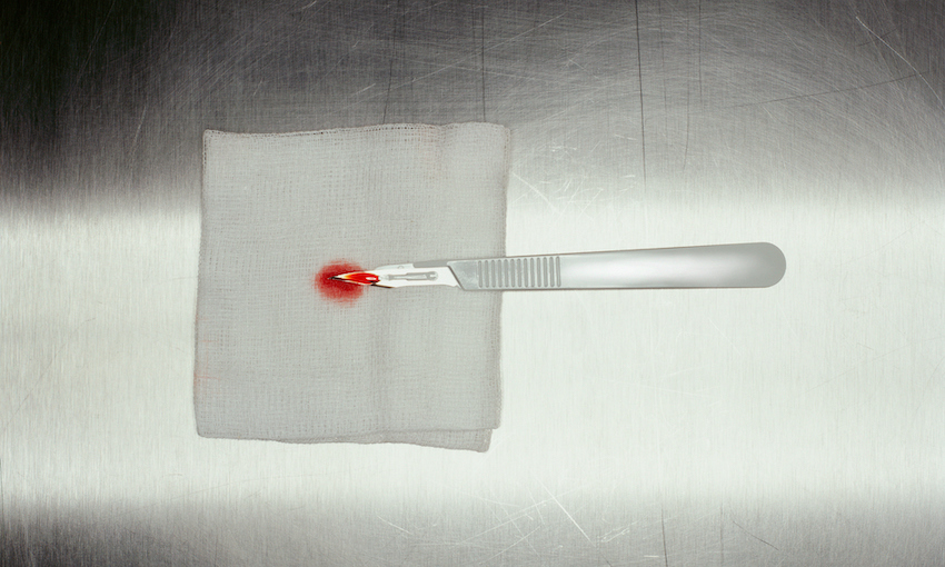 Scalpel with blood