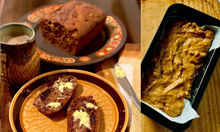 Slices of date load served on a brown ceramic dish with a cup of tea in a brown mug, and the uncooked date loaf on a loaf tin.