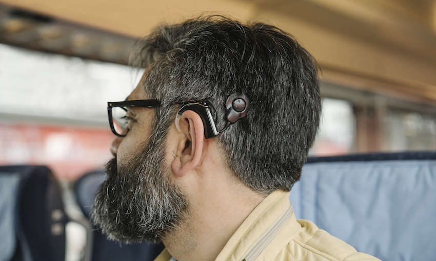 Man with cochlear implant