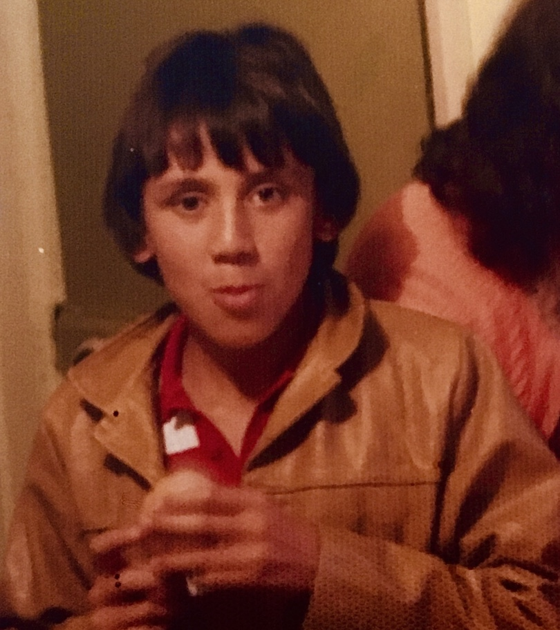 Old family photo of a boy aged approx 12? in an awesome tan leather jacket.