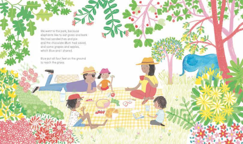 A spread from a picture book showing a family picnic, loads of flowers and trees, a blue elephant standing off to the side