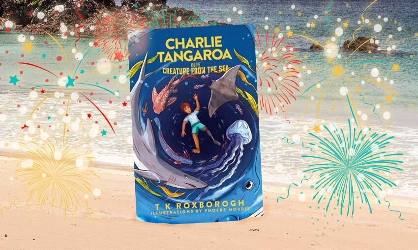 A chapter book with cover art of sea creatures is overlaid on a backdrop of fireworks, and a beach