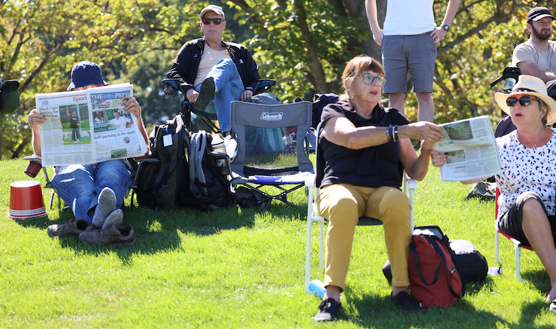 Boomers on lawn chairs read The Press, bright green grass, beaut day