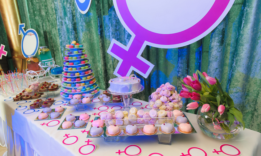 Cakes on display at a gender reveal party