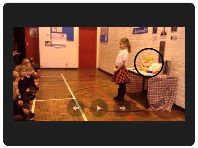 Screenshot of a video where a girl is presenting a project on Hairy Maclary