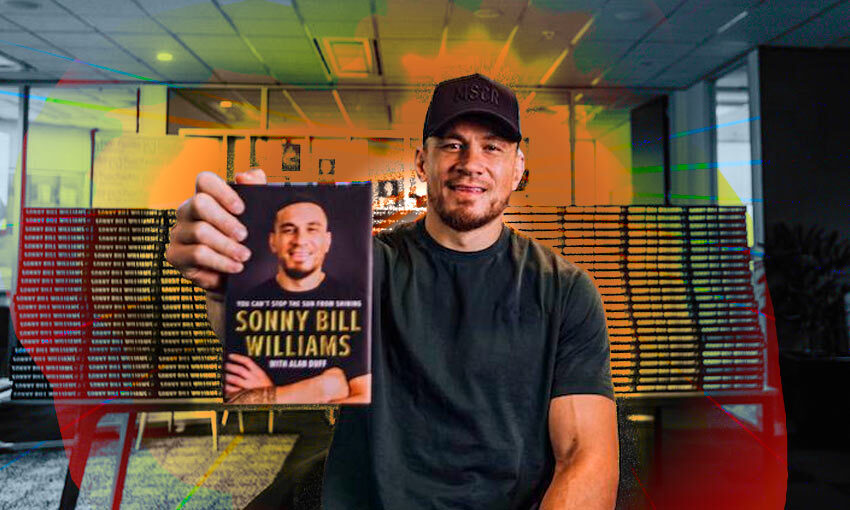 Sonny Bill Williams holding his autobiography, You Can't Stop the Sun from Shining